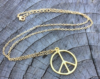 Gold Peace Sign . Necklace