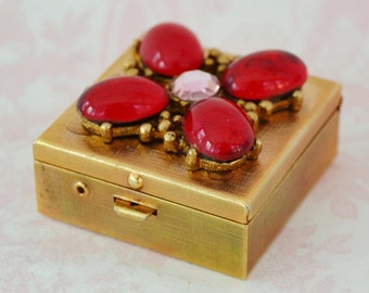 Vintage Pillbox with Ruby Red Glass Stones and a Pink Rhinestone from Prestige