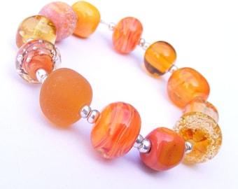 Lampwork orphan bead set of 12 orange renegade beads - amber lampwork orphan beads