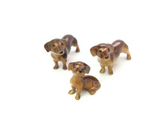 Miniature Figures. Dachshund Dog Figurines. Ceramic Family Set of Three. Red Brown Coats. Made in Japan, Shiken. Vintage 1950s Collectibles