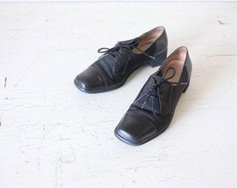 Salvatore Ferragamo Black Leather Oxfords