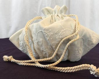Handmade White Linen Embroidered Drawstring Purse.  Wedding or Bridal Drawstring Purse. Oval Bottom of Purse with Gathers.