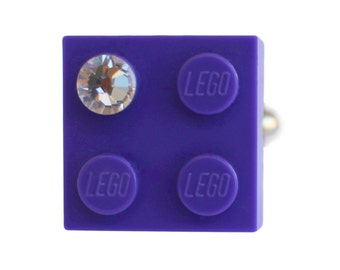 Purple LEGO (R) brick 2x2 with a Diamond color SWAROVSKI crystal on a Silver/Gold plated adjustable ring finding