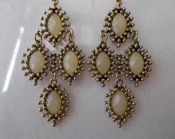 Gold Tone and Beige Layered Dangle Earrings