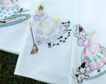 Set of five hand embroidered sweet maiden tea towels