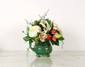 Floral Arrangement in Green Pottery Pitcher
