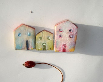 Three miniature wooden houses / Tiny colorful houses / Little rustic houses