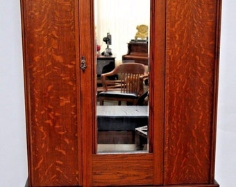 Gorgeous Tiger Oak Art Deco Armoire Wardrobe Closet Beveled Mirror Bottom drawer Nation Wide Shipping Available