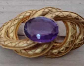 Vintage pinchbeck and purple stone brooch