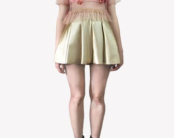 Gold faux leather mini skirt