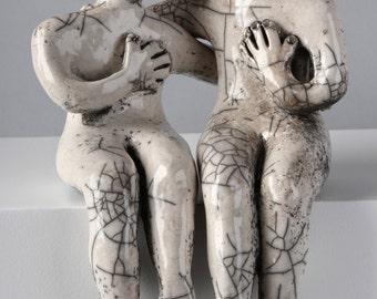 Raku Ceramics Couple. Unique Raku sculpture made of two separate figures hugging.