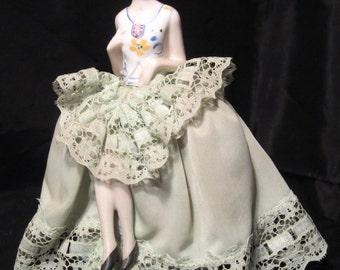 Art deco porcelain half doll pincushion with legs,flapper lady figurine; ca 1930 (D185)