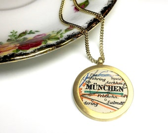 Medallion of your favorite city with vintage maps. Personalized. Gilded.