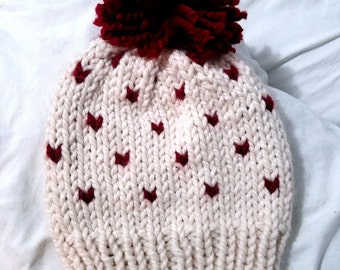 Adult sized knitted beanie with red hearts
