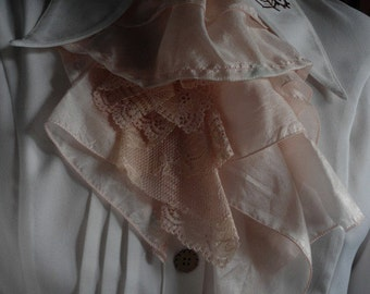 jabot in lace and pale pink fabric