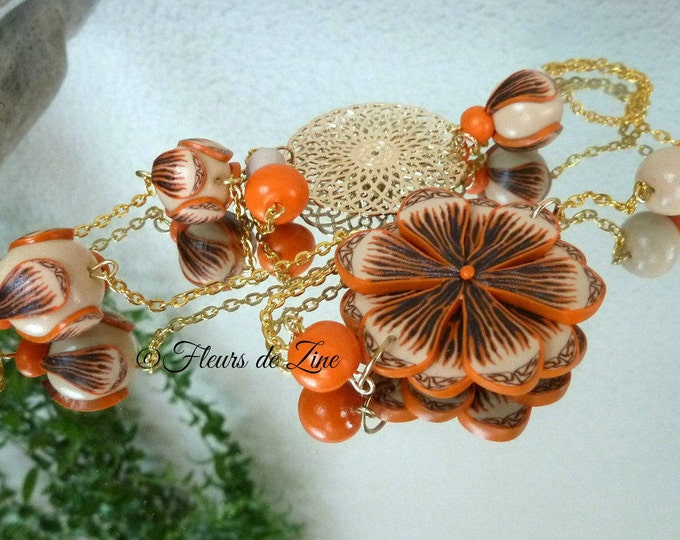 Clay polymer and gilded metal, sand and orange flower necklace