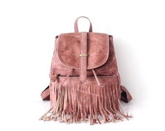 Pale pink leather backpack with fringe