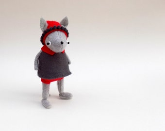 Cashmere Pup  -  Handmade Plush Dog wearing grey felt dress, red felt pants and matching red woollen hat.