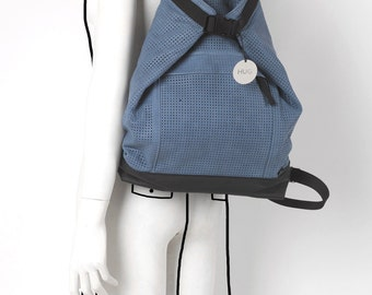 Leather perforated blue backpack