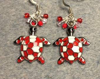 Large red and white enamel turtle charm dangle earrings adorned with tiny red Czech glass beads.