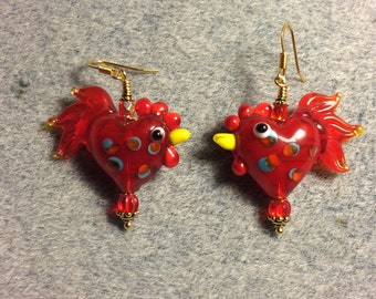 Red lampwork heart shaped rooster bead earrings adorned with red Czech glass beads.