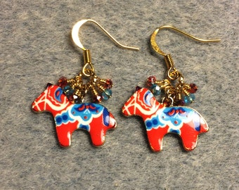 Red and turquoise enamel Scandinavian horse charm earrings adorned with tiny dangling red and turquoise Chinese crystal beads.