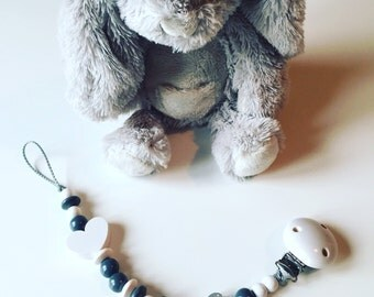 Attached nipple with grey and white wooden beads