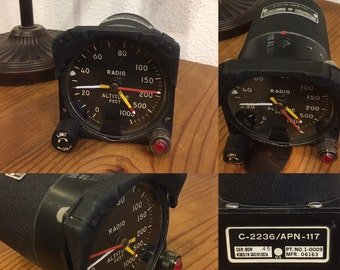 NOVEMBER-TANGO-XRAY:  desktop clock made from an aircraft gauge.  Second hand has sweeping smooth movement