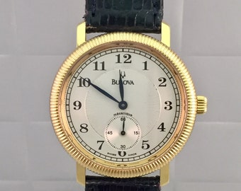 Rare Edition 100 pieces Limited Edition Manual mechanical BULOVA 18kt solid gold with guarantee card.
