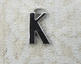 "Silver Wide Sans Serif Letter ""K"" Charm, 1 or 5 letters per package  ALF005k"