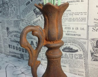 Old rusty candlestick cast-iron vase imitation rust and rusty metal industrial style candleholder