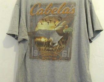 A Men's Vintage RETRO,Gray Short Sleeve Grunge T shirt By CABELA'S.xl