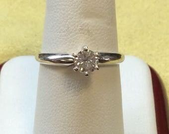 14K white gold diamond solitaire engagement ring. 0.5 carat.
