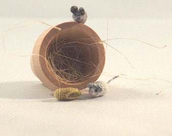 Micro crochet mice scenery, with flower pot and pistache nut