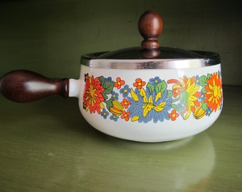 Vintage enamel pot with wooden handle and lid
