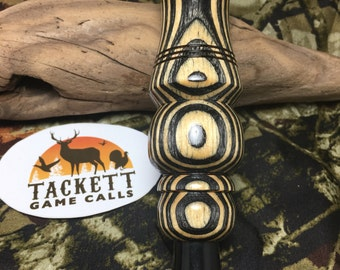 Black and white laminate double reed duck call.