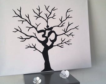 "Ink tree to zen ""OM"" prints for about 70-80 people with 1 4 colors available"