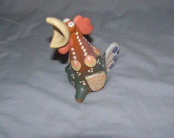 Ceramic whistle Cock. The symbol of the new year