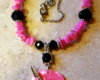Pink and black guitar necklace