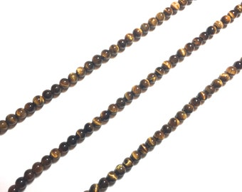 Tigers Eye Strands. Beads. Tigers Eye. Small and Large Beads.