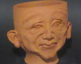 BERNIE, my Pothead Friend.  Made of plant-friendly Terra Cotta Clay, ready to warm your heart.