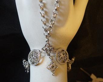 Silver charm slave bracelet