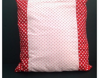 Pink cushion with red spots