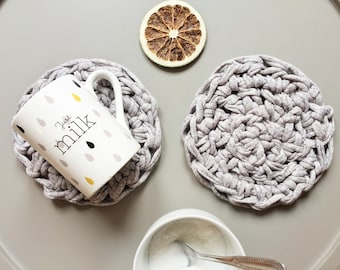 Two round gray crochet coaster set