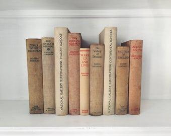 Books bound in oat/beige canvas