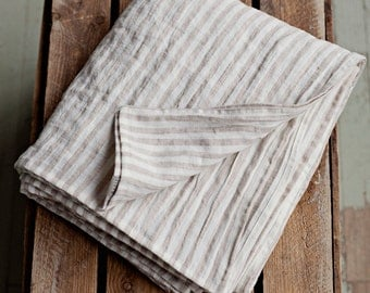 Stone washed flat linen bed sheet, striped in off white and natural linen colour. Twin, double, queen, king sizes.