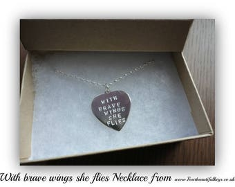 With brave wings she flies. Necklace