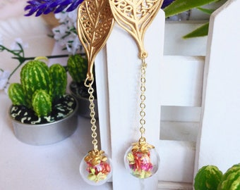 Brass ball chain glass leaf pendant earrings with colorful dried flowers.