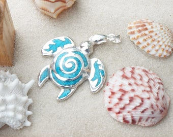 Silver sea turtle with turquoise chip inlay