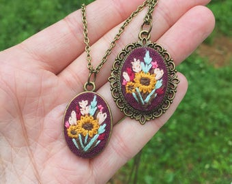 Sunflower Hand Embroidered Pendant Necklace, vintage inspired, boho style, burgundy linen, gold, floral embroidery design